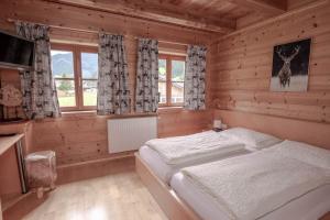 Ein Bett oder Betten in einem Zimmer der Unterkunft Astlhof