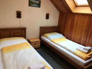 Postel nebo postele na pokoji v ubytování Penzion Trampska Bouda