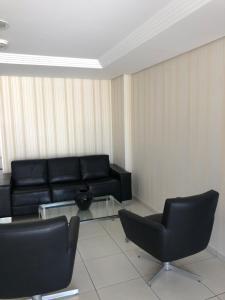 A seating area at Apartamento na Praia de João Pessoa