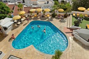 Uitzicht op het zwembad bij Alfagar Cerro Malpique of in de buurt
