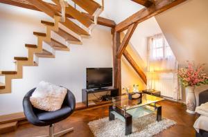 Coin salon dans l'établissement Carolline Apartments with SPA access