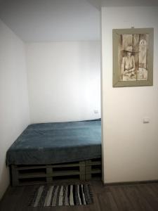 Кровать или кровати в номере Rauschen apartments