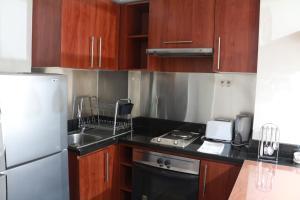 Una cocina o zona de cocina en Austral Rentahome Santa Beatriz