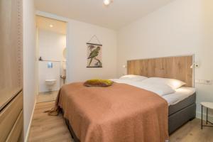 Ein Bett oder Betten in einem Zimmer der Unterkunft De Herberg Appartementen