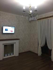 A television and/or entertainment center at STERILE Premium Apartment Mariupol in the center Paris style