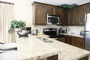 A kitchen or kitchenette at GRACE BAY BEACH -VILLA DEL MAR RESORT -LUXURY 2 BED UNIT - Winner of EXCELLENCE!!!