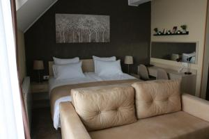 A bed or beds in a room at Lucky Kop Apartmani