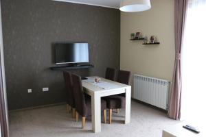 A television and/or entertainment center at Lucky Kop Apartmani