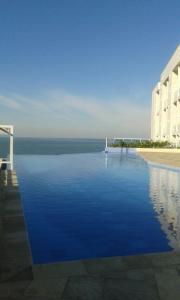 The swimming pool at or near Apartamento Guaruja Vacanze