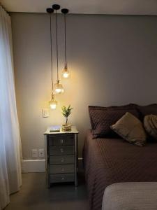 A bed or beds in a room at Estúdio novíssimo no Menino Deus