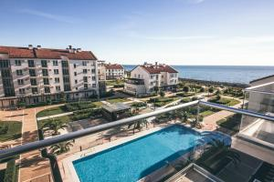 A view of the pool at Apart Hotel Imeretinskiy - Morskoy Kvartal or nearby