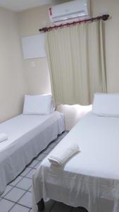 Cama ou camas em um quarto em Praia Apart Hotel