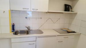 A kitchen or kitchenette at Downtown Apartment