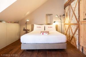Een bed of bedden in een kamer bij Dare Lisbon House