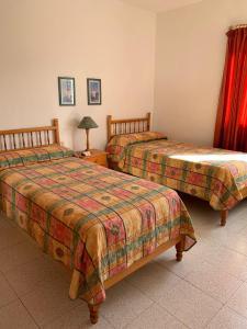 Een bed of bedden in een kamer bij Casitas Rosheli