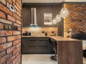 A kitchen or kitchenette at Loft House Premium Apartments