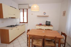 A kitchen or kitchenette at Villaggio Le Palme