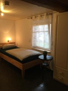 Ein Bett oder Betten in einem Zimmer der Unterkunft Ferienhaus Rosenblüte