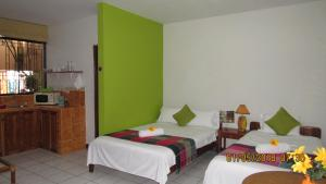 A bed or beds in a room at Nativa Apartments