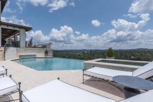 The swimming pool at or near THE ARRIVE ELEVATED ESTATE ON LAKE AUSTIN estate