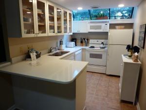 A kitchen or kitchenette at Seapines 600 Wildwood Spa Villas