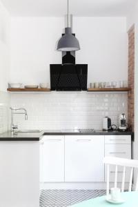 Kuchnia lub aneks kuchenny w obiekcie Good Time Apartments Jeżyce
