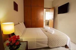 A bed or beds in a room at Pampulha Flat