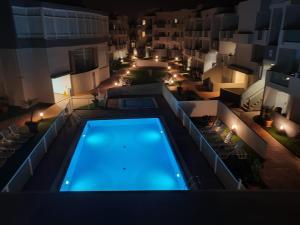 Výhled na bazén z ubytování GARDEN 128 nebo okolí