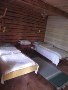 Vuode tai vuoteita majoituspaikassa Järvenukka Puhkemaja