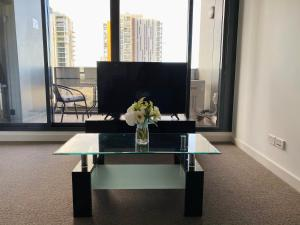 A television and/or entertainment center at Luxury 2 Bedroom Apartment - Adelaide CBD