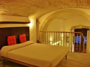 Letto o letti in una camera di Residenze Palazzo Pes