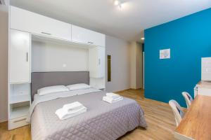 A bed or beds in a room at Athens Raise Acropolis Project