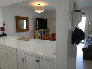 A kitchen or kitchenette at Seven Mile Beach Oceanfront Luxury Villa