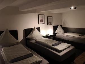 Ein Bett oder Betten in einem Zimmer der Unterkunft Ferienwohnung Nomeda