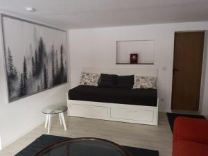 Ein Sitzbereich in der Unterkunft Ferienwohnung Nomeda