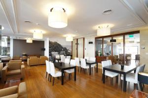 Restauracja lub miejsce do jedzenia w obiekcie Legendary Lisboa Suites
