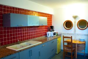 Küche/Küchenzeile in der Unterkunft Résidence Posidonie