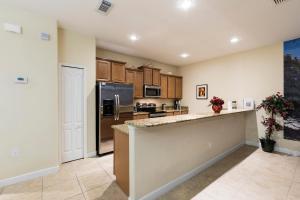 A kitchen or kitchenette at Paradise Palm Resort Villa
