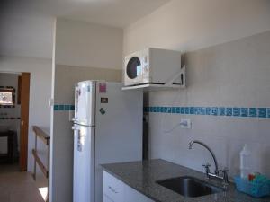 Una cocina o kitchenette en Cabañas Agreste