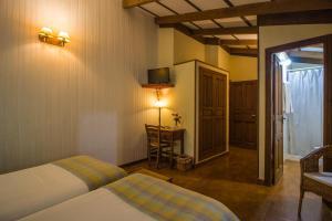 Cama o camas de una habitación en Casa Rural del Corral