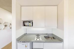 A kitchen or kitchenette at Maravilloso Estudio en La Boca