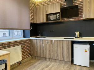 A kitchen or kitchenette at Студия ЛОФТ