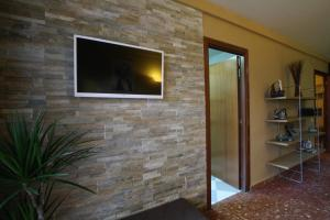 A television and/or entertainment center at Good-Apartments Barcelona