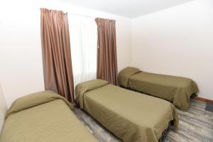 Una cama o camas en una habitación de Kau Si Aike