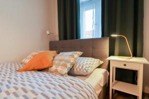 Un ou plusieurs lits dans un hébergement de l'établissement Riverside Central ApartMeet