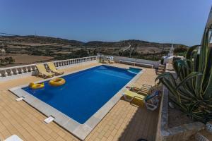 The swimming pool at or near Villa Akosua