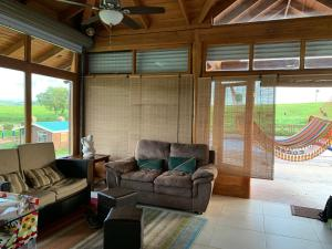 A seating area at Lake Arenal Casa Armonia