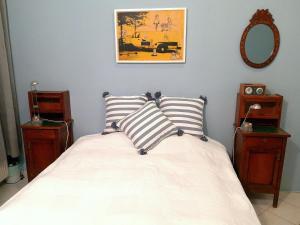 Ein Bett oder Betten in einem Zimmer der Unterkunft Basilica Central Apartment