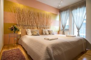 A bed or beds in a room at Prestige Apartamenty Stara Polana & Spa