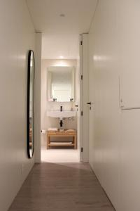 A bathroom at BessaApartments